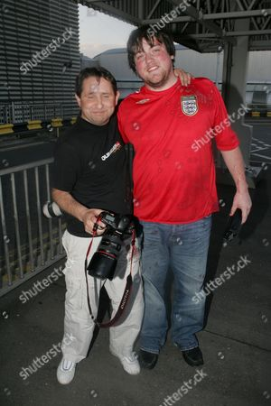 Photographer Carl Sims (r) covered in smoothie. Pete threw an Innocent smoothie over photographers as he arrived at Heathrow.
