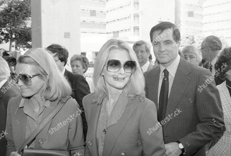 Actress Angie Dickinson, left, arrives at the same time as Mexican Ambassador Nominee John Gavin and his wife, Constance, for a memorial service for Jules Stein on in Los Angeles. Stein, who founded the giant MCA Inc., died on Wednesday