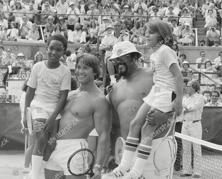 Grier Sanchez Schwarzenegger Actor and bodybuilder Arnold Schwarzenegger, second from left, and football player Rosey Grier, third from left, hold up their young opponents, left to right, Wesley Dixon, 10, and Robert Sanchez, 11, both of New Rochelle, at the RFK Celebrity Tennis Tournament in New York
