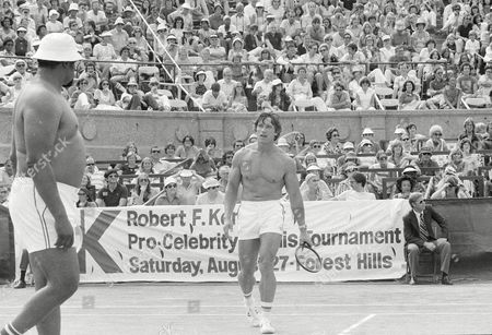Grier Schwarzenegger Actor and bodybuilder Arnold Schwarzenegger, and football player Rosey Grier team up during the RFK Celebrity Tennis Torunament in New York