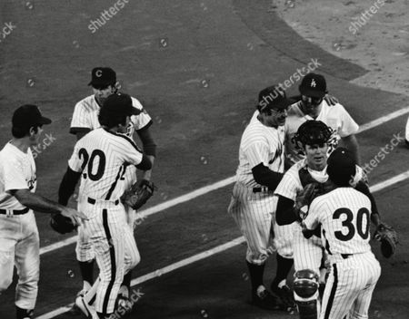 Yogi Berra, left, manager of the National League, with his arm around Mike Marshall of the Los Angeles Dodgers, catcher Jerry Grete of the New York Mets and Dave Cash (30) of the Philadelphia Phillies are happy group after the National League won the All-Star game 7-, 1974 in Pittsburg, Pennsylvania