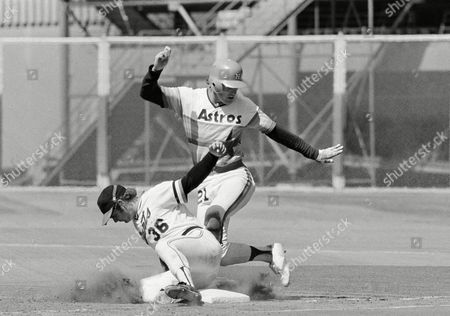 Terry Puhl, Jim Dwyer Houston Astros centerfielder Terry Puhl dances back into first base as Giants first baseman Jim Dwyer digs out a ninth inning pickoff attempt at Candlestick Park in San Francisco on . The Astros beat the Giants, 6-5, to gain a two-game series split