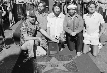 The rock ?n? roll group Beach Boys celebrate 20 years of surfing music with their star placed in the Hollywood Walk of Fame, in Los Angeles. The Beach Boys are, from left: Mike Love, Carl Wilson, Brian Wilson, Al Jardine and Bruce Johnston. Beach Boy Dennis Wilson did not appear at the ceremonies and Johnston has not been with the group for the entire twenty years