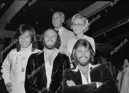 The Pop Group Bee Gees, foregroung left to right, Robin, Maurice and Barry Gibb pose with their parents Hugh and Barbara Gibb, . The Gibbs were at a party following the television screening of their UNICEF show in New York