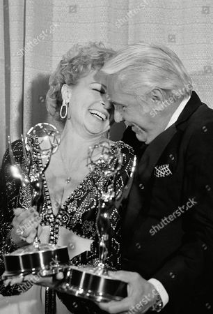 """Betty White shares a moment backstage at the 28th annual Emmy Awards with Ted Knight after they each won an Emmy for their supporting roles in """"The Mary Tyler Moore Show."""" On the series Miss White playes Sue Ann Nivens while Knight plays newscaster Ted Baxter"""