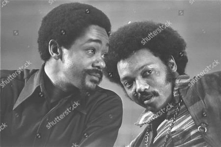 Bobby Seale, left, and the Rev. Jesse Jackson talk, Saturday night, at the National Black Political Convention in Gary, Indiana. Seale called for black unification around concrete programs for survival, and Jackson is director of PUSH, People United to Save Humanity