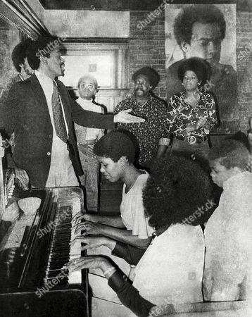 Bobby G. Seale Bobby Seale, left, Black Panther chairman who is running for mayor of Oakland, joins some campaign workers in a song at his headquarters in Oakland, . At the piano are Seale?s wife, Artie Seale, center, and Elaine Brown, foreground, a candidate for the City Council. Seale?s son, Malik, is at far right