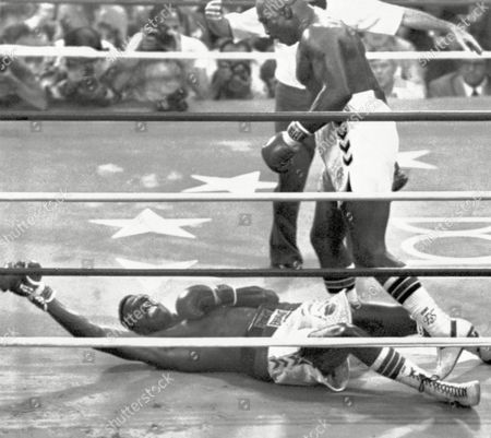 Earnie Shavers stands over Larry Holmes in the ninth round of their 15 round fight, in Las Vegas, after referee Dave Pearl ruled that Holmes fall was a slip. Holmes won the fight on a TKO in the elevnth round