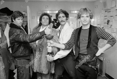 """Smith Dale Hays Kline Actors Robert Hays, left, and Jim Dale, second from left, have a try at the sword with Kevin Kline and Rex Smith, right, stars of the Broadway play """"The Pirates of Penzance,"""" after a performance in New York"""