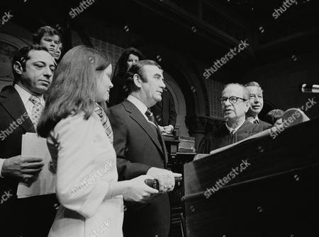 Helen Carey, Hugh Carey, Mario Cuomo, Mary Ann Krupsak, Malcolm Wilson, Charles Breitel With his right hand on a bible and his left arm at his side, Hugh L. Carey takes the oath of office of governor from Chief Judge Charles Breitel in Albany, N.Y., . Holding the bible is Carey's daughter Helen, 15. At right, former Gov. Malcolm Wilson and Lt. Gov. Mary Ann Krupsak listen. At left is Secretary of State Mario Cuomo and behind Cuomo is more of Carey's family