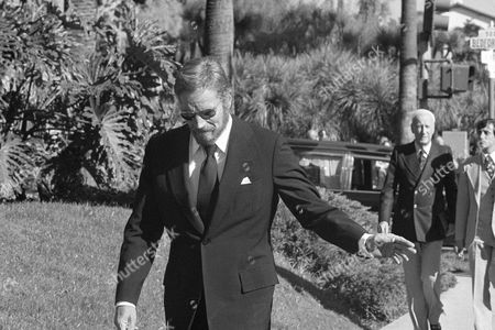 Charlton Heston Actor Charlton Heston arrives at the Church of the Good Shepherd in Beverly Hills, California, for the funeral of movie and stage actress Rosalind Russell