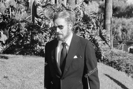 Stock Photo of Charlton Heston Actor Charlton Heston arrives at the Church of the Good Shepherd in Beverly Hills, California, for the funeral of movie and stage actress Rosalind Russell