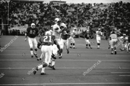 Mike Bayer (21), University of Texas safety, allows Bob Parsons (86), Penn State end, to take a pass good for 19 yards in the third quarter of the Cotton Bowl game in Dallas, . Two player later Penn State scored a touchdown. Bayer was injured in the first quarter and seemed dazed and missed several assignments in later action that led to Penn State gains