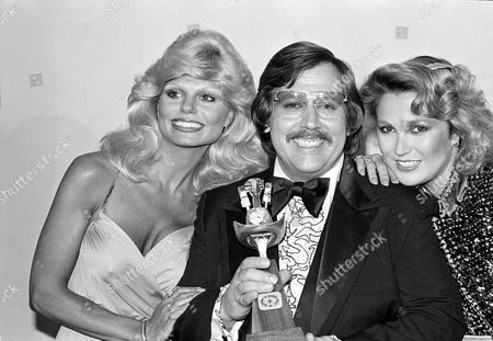 Conlee Anderson Tucker John Conlee holds his award for new male vocalist of the year at the 1978 14th Academy of Country Music Awards show in Los Angeles, Ca., . Conlee is flanked by actress Loni Anderson, left, and singer Tanya Tucker, presenters of the award