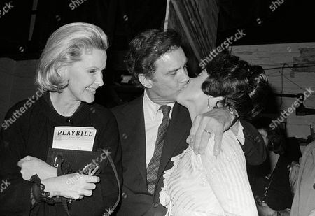 "Actor Cliff Robertson plants a kiss on Christine Andreas as Robertson's wife; actress Dina Merrill okays the scene with a broad smile after Miss Andreas opened as Eliza Doolittle in ""My Fair Lady"" in New York, on . It was the 20th anniversary edition of the long-running musical"
