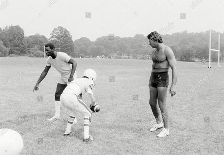 Doug Williams, Joe Namath Rookie quarterback, Doug Williams, left, and Joe Namath, right, watch a youngster work out at the Joe Namath-John Dockery Football Camp at Hamden, Conn