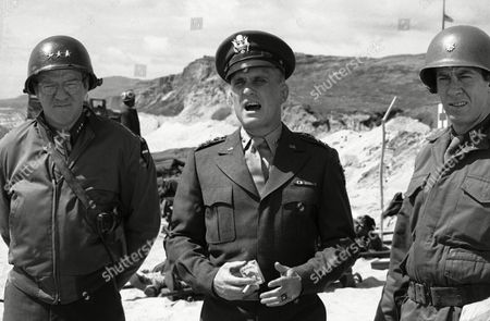 "Actor Robert Duvall in his role as Dwight D. Eisenhower is shown re-enacting his landing on Omaha Beach during World War II on the beaches of Camp Pendleton, Calif., . Duvall is flanked by actor Richard Herd, left, who plays General Omar Bradley and actor Paul Gleason, who plays a character named ""Tex"