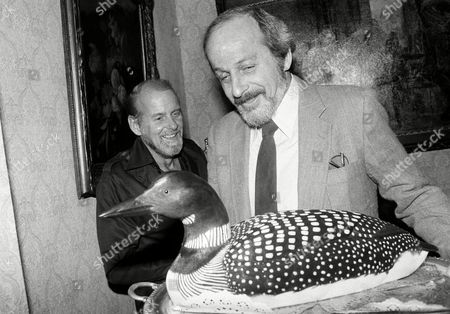 "E.L. Doctorow, Bob Fosse Author E. L. Doctorow admires a hand-carved loon presented to him at a party in New York, while Bob Fosse looks on. Doctorow, author of best seller ""Ragtime,"" has a new novel which will be on the best seller list next week called ""Loon Lake"