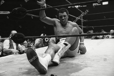 Heavyweight champion Muhammad Ali slips to the canvas in fourteenth round of his title fight with Earnie Shavers in New York?s Madison Square Garden on . Ali went on to win an unanimous decision over Shavers