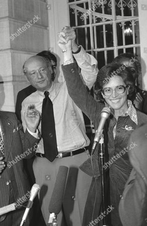 """New York City Mayor Edward I. Koch, a fervent supporter of defeated primary hopeful Bess Myerson, holds the hand of Rep. Elizabeth Holtzman aloft during a City Hall news conference, in New York. Koch said he'd """"do all I can to help"""" as he endorsed the primary winner in her race for the U.S. Senate"""
