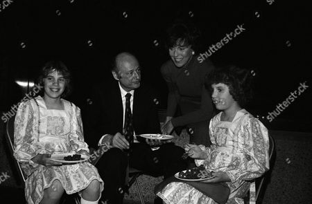 New York Mayor Edward Koch, center, talks with Bess Myerson, standing, and daughters of Idaho Congressman Steve Symms, Amy 11, left; and Katy, 9. Mayor Koch was hosting a reception and dinner for 70 members of congress who are visiting the city. Both events were held at the Whitney Museum at night, in New York