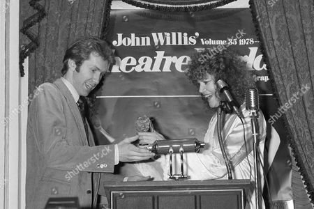 """Actress Eileen Brennan gives one of the 36th Annual Theatre World Awards to Harry Groener, who stars in the Broadway musical """"Oklahoma,"""" in New York. The awards are presented to the most outstanding new performers in Broadway and off-Broadway productions during the 1979-1980 seasons"""