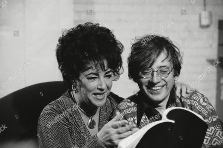 "Elizabeth Taylor goes over script with director Austin Pendleton during rehearsal on in New York for the Broadway revival of ""The Little Foxes"". Taylor, who has never appeared on Broadway, will open the show in April"