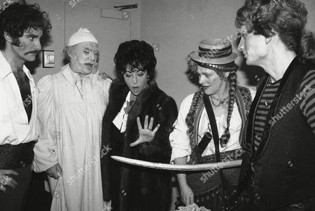 """Elizabeth Taylor, left, exclaims over sword held by Estelle Parsons, center, backstage on at the Uris Theatre in New York. Liz Taylor attended a performance of """"Pirates of Penzance,"""" which Parsons and Rex Smith, right"""