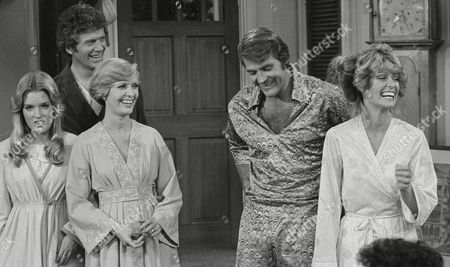"""Stock Photo of Actress Farrah Fawcett-Majors, right, joins her husband Lee Majors in a rare television appearance together in the sit-com """"The Brady Bunch,"""" . At left are actors Florence Henderson and Robert Reed, with Geri Reischl at left. The skit has the two couples unexpectedly moving into the same house"""