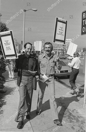Dennis Weaver, William Schallert Actors William Schallert, left, and Dennis Weaver join a host of other Hollywood names on the picket line as they march in front of the Academy of Motion Picture and Television producer's offices in Los Angeles, Calif., . They were protesting the film industry's portrayal of women and minorities on the film and TV screen