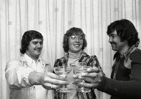 Bobby Clarke, center, of the Philadelphia Flyers, who won the Hart Memorial Trophy as Most Valuable Players in the NHL, is toasted with ginger ale - someone locked up the champagne - by teammates Michel Belhumeur, left and Bobby Taylor. The trio posed for cameras at an early news conference in Philadelphia