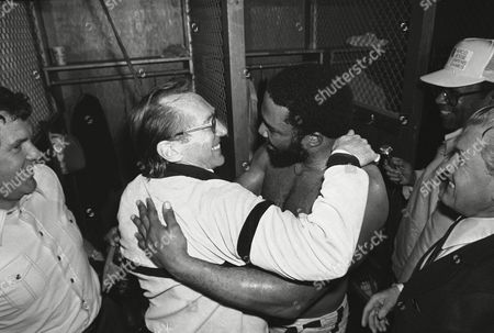 Oakland Raiders owner Al Davis, left, hugs Raiders' Kenny King in the locker room on after the Raiders beat the San Diego Chargers 34-27 in San Diego to win the AFC championship and advance to the Super bowl in New Orleans