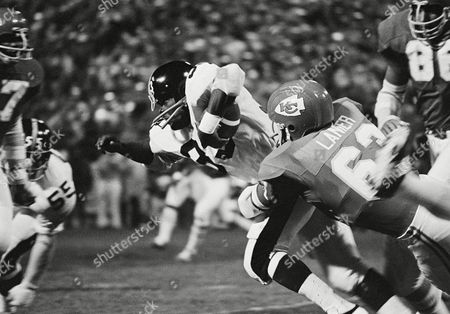 Pittsburgh?s John Fuqua, (33) manages a three-yard gain, but then is brought down by Kansas City?s Willie Lanier in game at Kansas City, on Monday, night, . The Chiefs won the game, 38-16
