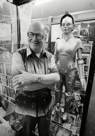 """Mr. Science Fiction"""", Forrest Ackerman, stands with the reproduction of the female robot Ultima Future Automation from the 1926 German film """"Metropolis"""" in his home in Los Angeles, on . The robot is surrounded by Ackerman's extensive collection of science fiction and fantasy memoriabilia"""
