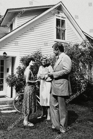 """Katha Pollitt, left, New York poet chosen to live in the house once occupied by Robert Frost in Franconia, N.H., talks with Sen. Edward M. Kennedy and his sister, Eunice Shriver, after Kennedy dedicated """"The Frost Place"""" in Franconia"""