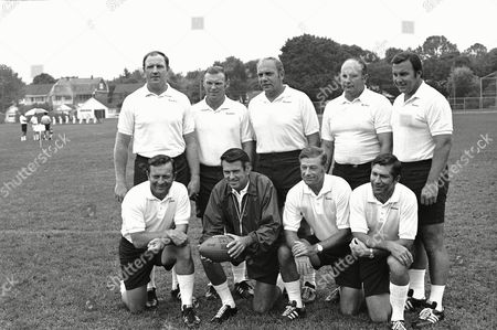 Washington Redskins coaching staff shown . Left to right, standing: Jack Pardee; Ralph Hawkins; Bill Austin; Lavern Torgeson and Dick Bielski. Kneeling, left to right: Ted Marchibroda; head coach George Allen; Charlie Waller and Paul Lanham