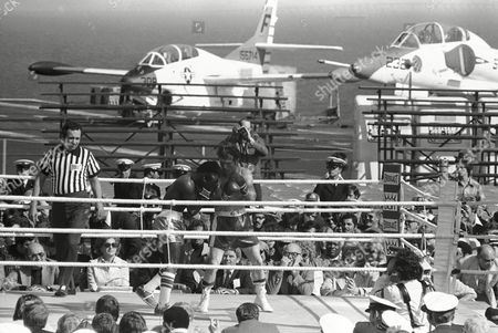 George Foreman George Foreman a punch sparring in a ring set up amid the piston and jet planes on static Naval Aviation Museum at the Pensacola Naval Air Station, . He'll meet Pedro Augusto of in Pensacola, January 22