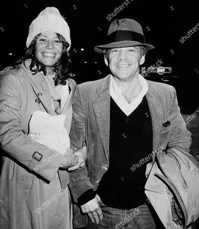 "Watchf Associated Press Domestic News New York United States GONG SHOW Chuck Barris, host of the television's ""Gong show,"" and friend Robin Altman leave the Pierrre Hotel in New York Wednesday night, . According to the photographer Barris said he and Altman would be married on Sunday"