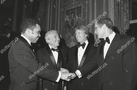 Former Georgia Gov. Jimmy Carter, second from right, shakes hands with prominent New Jersey officials at the New Jersey Democrats' Jefferson- Jackson Day dinner, where he was a speaker on at New York?s Waldorf Astoria Hotel. Peter Rodino, second from left, chairman of the House Judiciary Committee was honored and the recipient of an award. Newark, N.J. Mayor Kenneth Gibson at left, with New Jersey Gov. Brendan at right