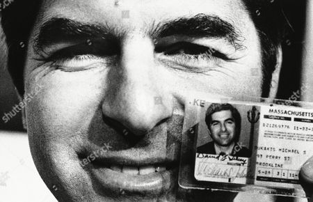 Gov. Michael S. Dukakis, after calling on Massachusetts drivers to participate in a life-saving organ donor program, shows special decal affixed to his drivers license, indicating his participation in the program on in Boston. Under the donor program a driver wills a kidney, cornea, or other organs for use in transplant surgery and medical research