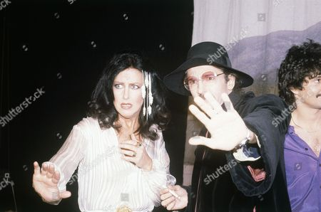 "Singer Grace Slick of the Jefferson Starship, left, and comedian Don Novello of ""Saturday Night Live"" in character as Father Guido Sarducci, mug for the cameras, . Mickey Thomas, also of the Starship is partially shown at right"