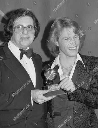 Record producer Phil Ramone and singer Andy Gibb smile at the Grammy Awards in Los Angeles