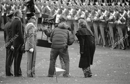 """Gregory Peck Camera crew moves in for a close-up of actor Gregory Peck, second from left, who is portraying World War II hero Gen. Douglas Mac Arthur. Peck and film crew were doing a final sequence of """"Mac Arthur"""" reviewing the corps of cadets at the U.S., military academy on parade"""