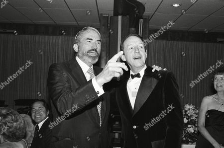 Stock Image of Gregory Peck, William Schallert Actor Gregory Peck, left, sporting a beard, points out someone to actor William Schallert, formerly of the Patty Duke Show, during the Girls Friday of Show Business 1979 Celebrity Benefit Ball in Los Angeles, Calif
