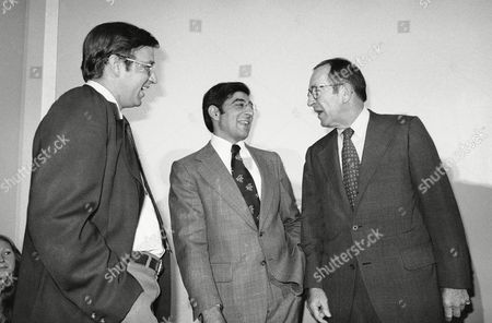 Stock Picture of Rep. Edward W. Pattison, D-N.Y., left, Rep. Leon H. Panetta, D-Calif. center, and Attorney General Griffin Bell share a light moment before a briefing in Washington on . Bell briefed members of Congress regarding the progress of the Korean CIA investigation by the Department of Justice