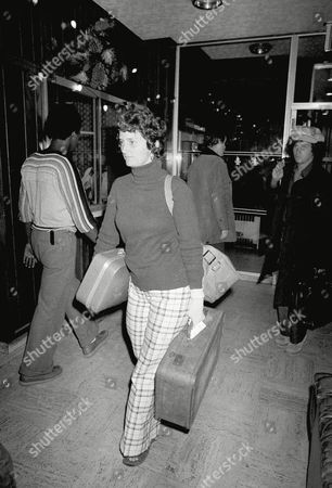 Laura Johnston, a nine-year member of the peoples temple, arrives early, at a hotel near New York's John F. Kennedy Airport after a flight from Guyana, site of he Cult's murder-suicide. She told reporters that all 17 of those who arrived in New York Wednesday, night had been subpoenaed to appear in U.S. District court in San Francisco before a grand Jury investigating the death in Guyana of Rep. Leo Ryan, D-Calif
