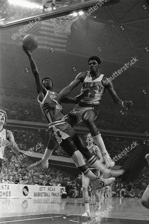 Shows Phil Ford, left, of North Carolina and Tony Smith (22) of Nevada, Las Vegas, right, going into the air as Ford drives for a shot during semifinals of the NCAA basketball tournament in Atlanta. On Ford was announced as part of the 10-member class that will be inducted into the National Collegiate Basketball Hall of Fame in November. The rest of the class includes Patrick Ewing from Georgetown, Earl Monroe from Winston-Salem State, Willis Reed of Grambling. and Cylde Lovellette of Kansas was selected along with Ford and Wyoming's Kenny Sailors. Dave Robbins, who won more than 700 games at Virginia Union, and joins former Kentucky coach Joe B. Hall as the two coaches to be inducted. Businessmen Jim Host and Joe Dean will go in as contributors