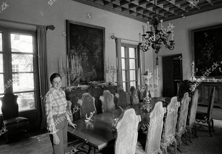 Granddaughter, Suzanne Lloyd Guasti, 21, checks the arrangements of the dinning table in the formal dining room in the Harold Lloyd home in Beverly Hills in May 1973