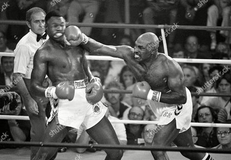 Shavers Holmes Challenger Earnie Shavers drives a right hand to the head of heavyweight champion Larry Holmes during their title fight in Las Vegas, Nev., Friday night, . Shavers knocked Holmes down, but the champion defended his title with an 11th round TKO