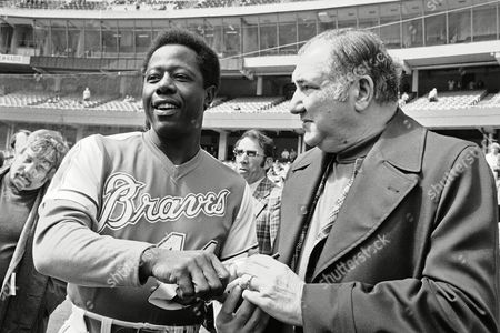 """Henry Aaron,Mike Shannon Atlanta Braves home-run king Henry Aaron was honored in pre-game ceremonies at night on in St. Louis. Former St. Louis Cardinals great Stan """"The Man"""" Musial exchanges a joke with Aaron during the presentation of a plaque. Aaron hit his first major league home run against the Cardinals pitcher Vic Raschi on April 23, 1954. At right is former major leaguer, and now Cardinals broadcaster Mike Shannon"""